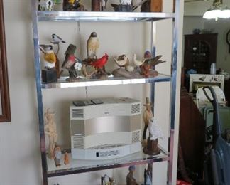 Hand carved birds, Bose wave radio/cd, glass shelf
