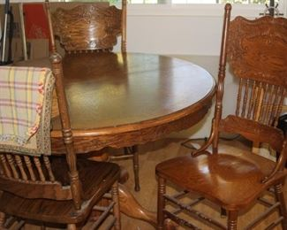 Pedestal table and chairs.