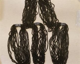 approximately 50 strands of 8 mm black glass beads