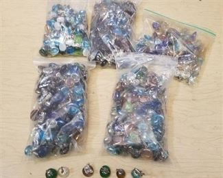five bags of assorted figurines on glass half Moons