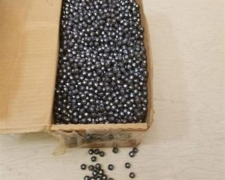 a box of 8 mm round faceted jewelry beads