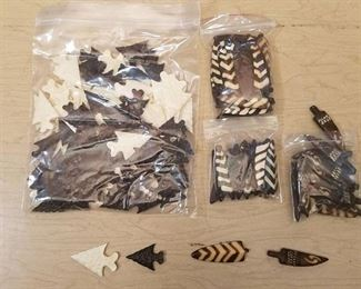 assorted arrowheads and necklace pendants