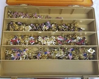 tackle box with assorted USA themed pins