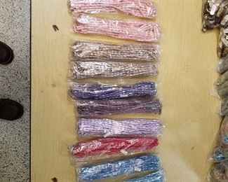 10 bags of assorted beaded strands - approximately 10 strands per bag