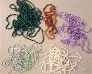 approximately 50 strands of beads - assorted colors