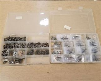 two storage organizers full of assorted pendants - very neat
