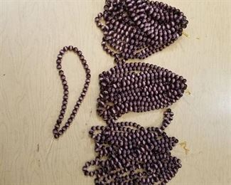 approximately 30 beaded strands - 10 mm - dark purple
