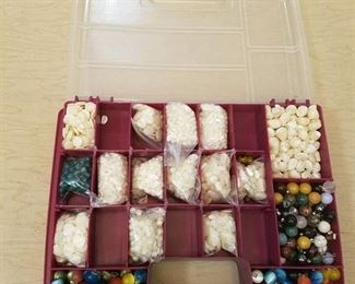 double sided organizer box with assorted jewelry beads and pendants