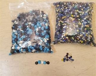two bags of assorted jewelry beads