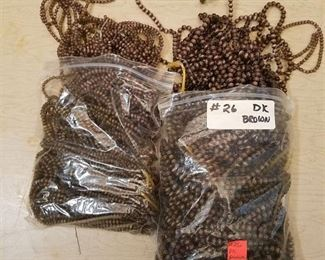 two bags of brown beaded strands - 2 different sizes