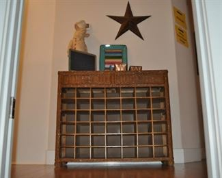 Wicker buffet/wine storage with drawers, Chef Pig holding a chalkboard, serving tray, candles, large metal star