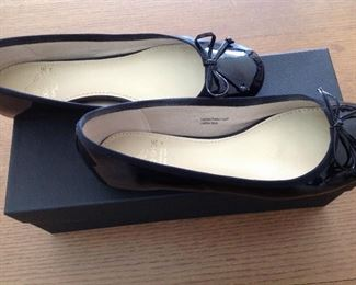 "SAKS FIFTH AVENUE BLACK PATENT LEATHER FLATS WITH BOW AND 1/2"" COVERED WEDGE: Size: 6.5. Grosgrain ribbon detail. Condition: Very good. Price: $100."