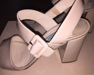 PRADA VERNICE CIPRIA NUDE BLOCK HEEL OPEN-TOE SANDAL: Size 37. Heel Height: 3 inches. From 2019 summer collection. Made in Italy. Condition: Scratches, scuffs, knicks and wear throughout. Retail Value: $600. Price: $100.