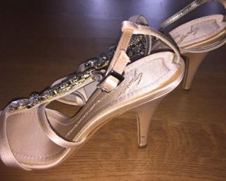 GIUSEPPE ZANOTTI SOFT PINK JEWEL EMBELLISHED SATIN STRAPPY EVENING SANDAL: Size 37.5 inches. Heel height: 4 inches. Made in Italy. Condition: Very good. Marks on both heels. Retail Value: $2,125. Price: $300.