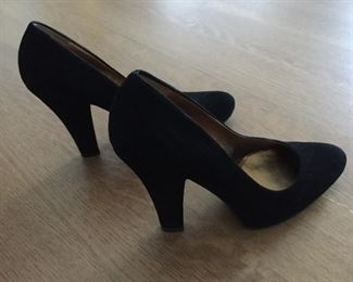MIU MIU BLACK SUEDE PUMPS: Size: 37. Heel Height: 4.5 inches. Condition: Very good. Shoe runs big for Size 7 so pads were inserted in shoe bottom and around back. Price: $100.