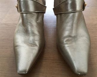 SALVATORE FERRAGAMO METALLIC GOLD-TONE LEATHER KNEE-HIGH BOOTS WITH RHINESTONE/PEARL EMBELLISHMENT: Size 7. Tonal strap accents at ankles. Covered heels and zipper closures at instep. Pink leather interior. Calf circumference: 13 inches. Shaft: 14.5 inches. Heel Height: 1.25 inches. Condition: Good. Faint scuffs and blemishes throughout. Price: $200.