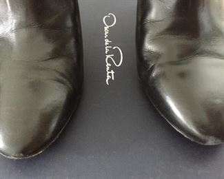 OSCAR DE LA RENTA BLACK LEATHER ANKLE BOOTS: Size 8 or 38.. Round-toe ankle boots with black matte and metal tone ombre block heels. Size 8 or 38. Heel Height: 3.5 inches. Condition: Good. Light scratches on toe, body and heels. Retail value: $890. Price: $200.