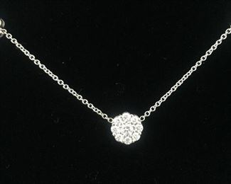 "DIAMOND FLEURETTE 18 KT WHITE GOLD AND 1.64 CARAT DIAMOND NECKLACE: LOTS OF FIRE AND SPARKLE.  Signed appraisal report included. Gift Box Included.  One stamped and tested 18KT white gold lady's hand assembled three diamond cluster necklace with a shared prong set.  18KT white gold lobster clasp and bright polish finish.  Identified with markings of ""18kt/750"".  Condition: Excellent. Light scratches on metal.   Total Weight of Diamonds: 1.64 ct.  Total Weight of Three Diamond Cluster Necklace: 6.00 gm.  Three shared prong set round brilliant cut diamonds exact total weight of 3 stones = 0.52 ct.  Clarity: VS. Color: F. Cut: Excellent  Twenty-four shared prong set round brilliant cut diamonds exact total weight 24 stones = 1.12ct.  Clarity VS. Color: F-G. Cut: Excellent.  Price: $2,900"