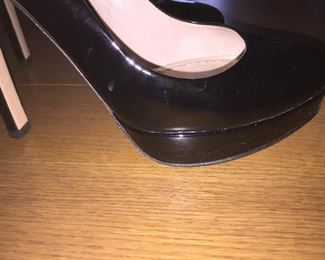 MIU MIU BLACK PATENT LEATHER PLATFORM PUMPS: Size 37. Heel Height: 5 inches. Platform Height: 1 inch. Price: $100.