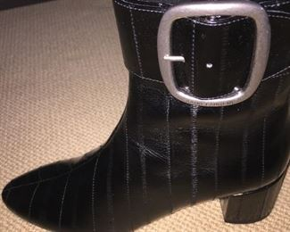 YVES ST. LAURENT BLACK EEL SKIN ANKLE BOOTS: Size 7.5. Condition: New. Excellent. Price: $200.