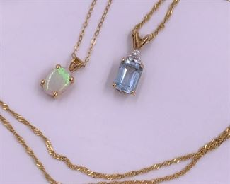 Gold necklaces with opal and gemstones