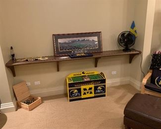Michigan Wolverines pillows, throws, toy box, chess pieces.
