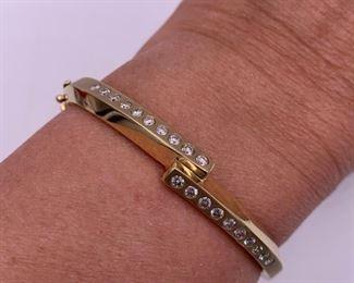 14K and diamond bangle bracelet - approximately 1 carat of diamonds