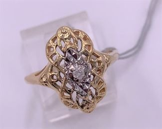 14K gold with small diamond center