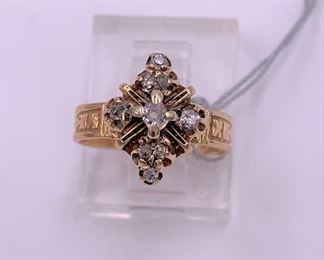 Child sized 14K gold and diamond ring.