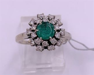 Vintage diamond and emerald ring in 14K white gold.