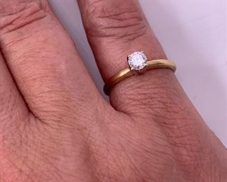14K gold and diamond solitaire ring.