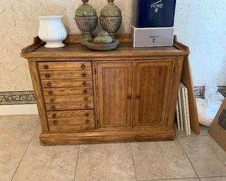 Wooden sideboard or buffet with storage. $100. Missing one knob
