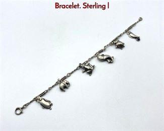 Lot 25 GEORG JENSEN Sterling Silver Charm Bracelet. Sterling l