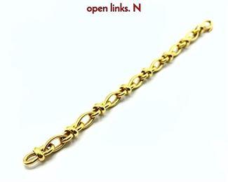 Lot 83 18K Heavy chain link bracelet. Decorative open links. N
