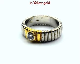 Lot 84 18K White Gold Band Ring. Center Diamond in Yellow gold