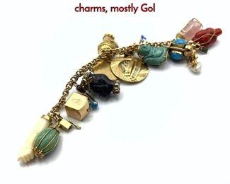 Lot 95 14K Gold Charm Bracelet. Large heavy charms, mostly Gol