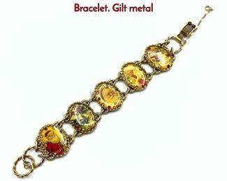 Lot 154 MAXIMAL ART by JOHN WIND Christmas Bracelet. Gilt metal