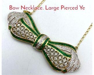 Lot 48 18K Gold Diamond Emerald Bow Necklace. Large Pierced Ye