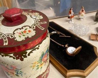 Vintage tea canister. Antique pocket watch