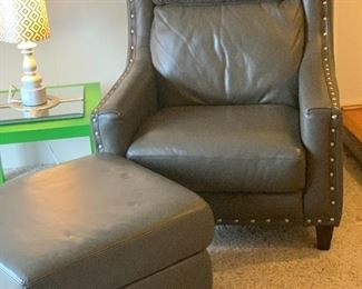 GREY LEATHER CHAIR AND OTTOMAN
