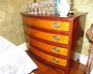 Antique mahogany and birds eye maple bowfront Hepplewhite chest with 4 drawers