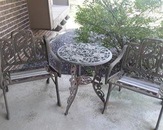 Iron and teak patio set