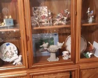 China cabinet.  Bird plates, statues, bath, pictures.  Collection.