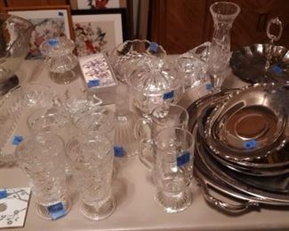 Silverplate serving pcs. and Tea set.  Crystal glassware.