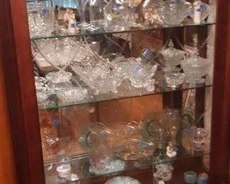 Vintage Display Curio, glass plate shelves.  Lock and key.  Sliding door slides to right or left.  Vintage Glass.  Misc. decorative items