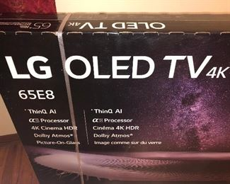 CLOSE UP VIEW OF NEW FACTORY SEALED BOX OF LG OLED TV WITH RARE 4 K - 65 INCHES