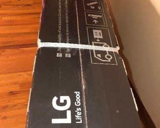 CLOSE OF VIEW OF NEW FACTORY SEALED BOX OF LG OLED TV WITH RARE 4 K - 65 INCHES