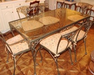 Glass and metal table with six chairs