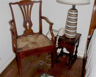 side table, arm chair rush woven seat, close up of 50's lamp, moose hooked rug
