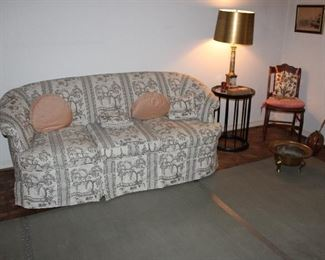 Vintage oriental print sofa, round side table
